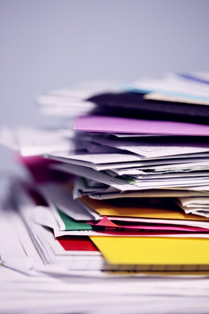 piles of paper clutter, declutter, homes revamped